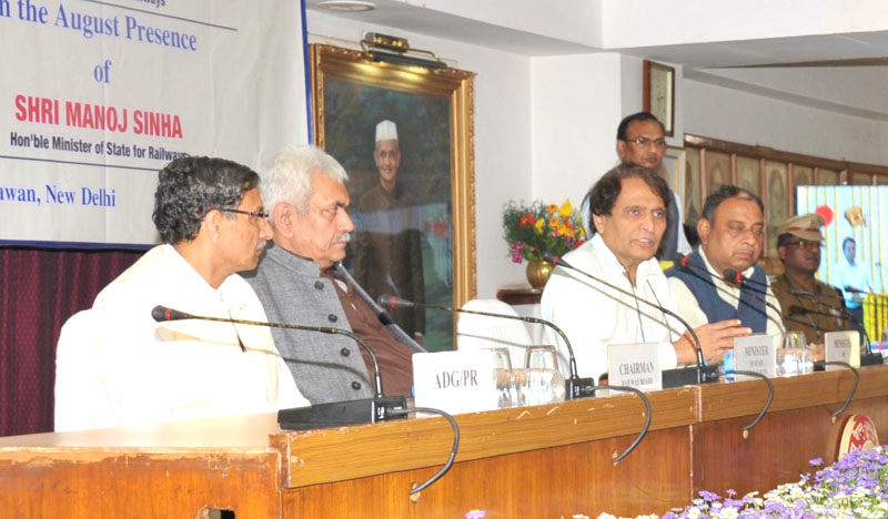 "The Union Minister for Railways, Shri Suresh Prabhakar Prabhu addressing at the launch of the ""Clean My Coach"" Service at New Delhi/Northern Railway, Mumbai Central/Western Railway & Lucknow Jn /North Eastern Railway Stations, through Video Conferencing from Rail Bhavan, in New Delhi on March 11, 2016. 	The Minister of State for Railways, Shri Manoj Sinha and the Chairman, Railway Board, Shri A.K. Mital are also seen."