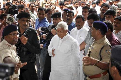 Indian politician and leader of Rashtriya Janata Dal, Lalu Prasad Yadav arrives at a special court held by Central Bureau of Investigation (CBI) for a verdict on fraudulent transfer of public money, in Ranchi, India, Monday, Sept. 30, 2013. Lalu was convicted by the court in the case, largely termed as fodder scam, where money was illegally withdrawn from the treasury by Animal Husbandry Department when he was the chief minister of the central Indian state of Bihar. The quantum of the sentence will be declared on Oct. 3. (AP Photo/Sasanka Sen)