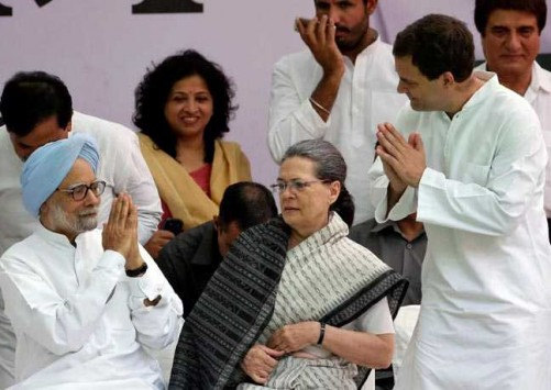 "NEW DELHI, MAY 6 :- Former prime minister Manmohan Singh (L) is greeted by India's main opposition Congress party's vice-president Rahul Gandhi as the party's President Sonia Gandhi (C) looks on before what the party calls ""Save Democracy"" march to parliament in New Delhi, India, May 6, 2016. REUTERS-11R"
