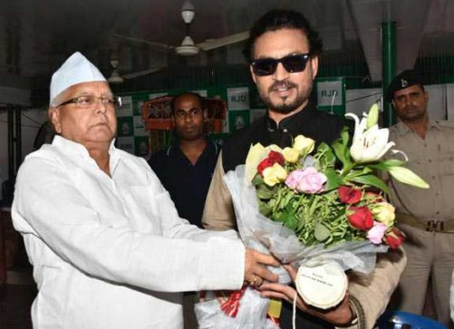 PATNA, JULY 7 (UNI):-RJD Chief Lalu Prasad greeting Bollywood actor Irrfan Khan on the occasion of Eid-ul-Fitr in Patna on Thursday. The actor was in town for the promotion his coming film 'Madari', on Thursday. UNI PHOTO-188U