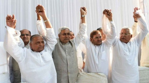 (L-R) Samajwadi Party chief Mulayam Singh Yadav, Nitish Kumar, chief minister of Bihar, Sharad Yadav of the Janata Dal (United) party, Lalu Prasad Yadav of Rashtriya Janata Dal party pose for photographers ahead of a press conference in New Delhi on April 15, 2015. Six Indian left-leaning and regional political parties vowed to work together to take on Prime Minister Narendra Modi's right-wing Bharatiya Janata Party ahead of key Bihar state elections scheduled later in the year. AFP PHOTO / SAJJAD HUSSAIN