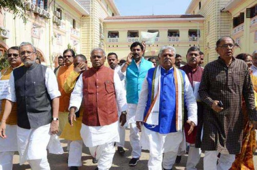 Patna: NDA legislators taking out a Raj Bhawan march during protest against Bihar's minister for excise and prohibition Abdul Jalil Mastan's remarks on PM Narendra Modi, at budget session in Patna on Thursday. UNI photo by- Pappi Sharma.